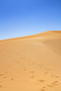 Sand dunes and cloudless blue sky Stock Photos