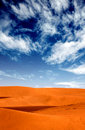 Sand dunes landscape with a blue sky Royalty Free Stock Photos