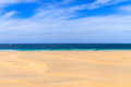 Sand dunes near to the ocean with cloudy blue sky, Boavista, Cap Royalty Free Stock Photo