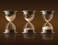 Sand falling in the hourglass in three different states on dark background vector illustration Stock Photos