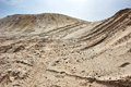 Sand hills over blue sky with car tires footprint Stock Photo