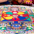 Sand mandala a spiritual and ritual symbol in hinduism and buddhism making by tibetan monk Royalty Free Stock Image