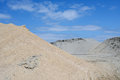 Sand mound against blue sky Stock Images