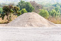 Sand mound for construction on the field of forest Stock Photos
