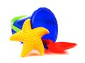 Sand pail and shovel toy with starfish over a white background Stock Images