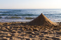 Sand pyramid structure on a beach with the ocean in the background Royalty Free Stock Photography
