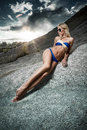 Sand rocks young lady in bikini lying on Royalty Free Stock Photos