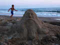 Sand sculpture and boy Royalty Free Stock Photo