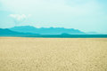 Sand, sea and mountain lanscape Royalty Free Stock Photo
