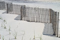 Sand shadows a beach fence casts on the mid day sun in surf city along the new jersey shore Stock Images