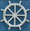 Sand ship wheel made of Royalty Free Stock Photo