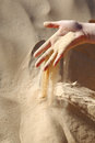 Sand slipping through fingers Stock Image