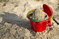 Sand toys, a red bucket and a scoop on the sand, Royalty Free Stock Photo