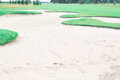 Sand trap at golf course Stock Photos