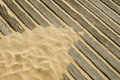 Sand on wooden deck Stock Photo