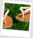 Sandals in the grass Stock Images