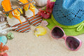 Sandals hat and sunglasses on the sand summer beach concept Stock Photos