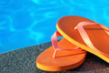 Sandals by a pool photo of close up Royalty Free Stock Photo