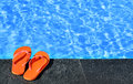 Sandals by a pool photo of pair Stock Images