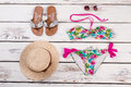 Sandals, straw hat, swimsuit, sunglasses. Royalty Free Stock Photo