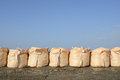 Sandbags for protection big against a blue sky Royalty Free Stock Photo