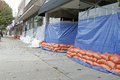 Sandbags to fight flooding store owners have sand bags and tarps in place for the coming flood waters and storm which will hit the Royalty Free Stock Photo