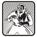 Sandblaster sand blaster woodcut retro illustration of a worker holding sandblasting hose wearing helmet visor set inside square Stock Images