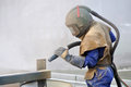 Sandblaster at work tradesman sandblasting beams for building project Royalty Free Stock Images