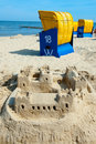 Sandcastle and beach chair on the beach Royalty Free Stock Photography