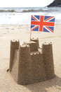 Sandcastle On Beach With Union Jack Flag Royalty Free Stock Photo