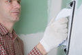 Sanding the drywall mud contractor using sand trowel Stock Image