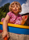 Sandpit fun girl playing in the in the home garden Stock Photography