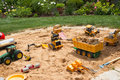 Sandpit in a garden with different sand play things. Royalty Free Stock Photo