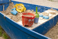 Sandpit in a rowboat blue Stock Images