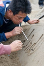 A sandsculpture artist at work Royalty Free Stock Photo