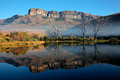 Sandstone mountains and reflection with symmetrical in water royal natal national park south africa Stock Photos