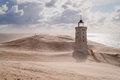 Sandstorm at the lighthouse Royalty Free Stock Photo