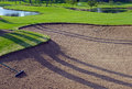 Sandtrap and Mancured grass of golf course Royalty Free Stock Photo