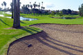 Sandtrap and Manicured grass of golf course Royalty Free Stock Photo