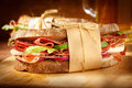 Sandwich with bacon and vegetables on vintage wooden board Royalty Free Stock Photo