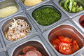 Sandwich bar salads choice in metal containers Royalty Free Stock Photo