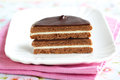 Sandwich biscuit with layered chocolate, halved Royalty Free Stock Photos