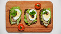Sandwich on black bread with egg and sardines Royalty Free Stock Photo