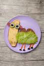 Sandwich camel made on pink plate and wooden background