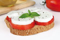 Sandwich caprese with alhabaca on white background Stock Photo