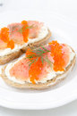 Sandwich with cream cheese salted salmon and red caviar on a plate closeup vertical Royalty Free Stock Photos