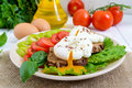Sandwich with egg poached, lettuce, black bread with seeds, tomatoes, sweet pepper Royalty Free Stock Photo