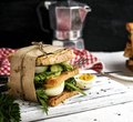 Sandwich of French toast and lettuce leaves and boiled egg Royalty Free Stock Photo