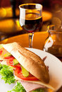 Sandwich and glass of wine jar Royalty Free Stock Photography