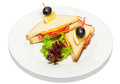 Sandwich with ham cheese lettuce and olive on plate restaurant menu Stock Photography